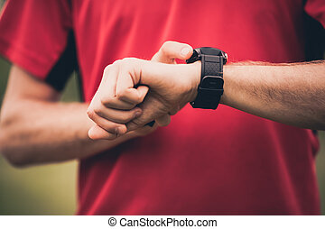 Runner training and using heart rate monitor smart watch -...