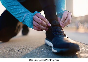 Runner trying running shoes getting ready for run - Runner...