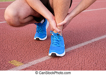 Runner with injured ankle on track