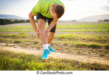 Runner with injured calf - Runner leg and muscle pain during...