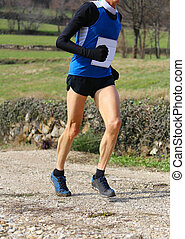 runner with sports wear during cross-country on a country road