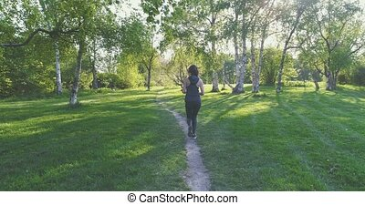 Runner woman dressed in sportwear running in park