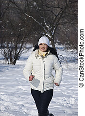 Runner woman in snow