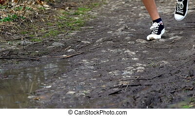 Runner woman jogging through puddles. Running in any...