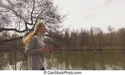 Runner woman running in park exercising outdoors fitness