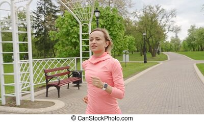 Runner - woman running outdoors, training, weight loss concept.