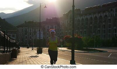 Runner woman running running in the park.