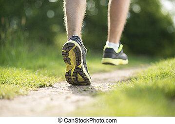 Runner - Young man is running in sunny nature