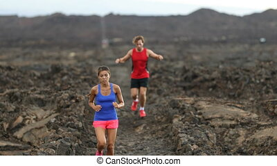 Runners - Determined Athletic Couple Running In Arid ...