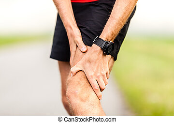 Runners leg knee pain injury - Runner holding sore leg, knee...