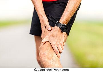 Runners leg knee pain injury - Runner holding sore leg, knee...