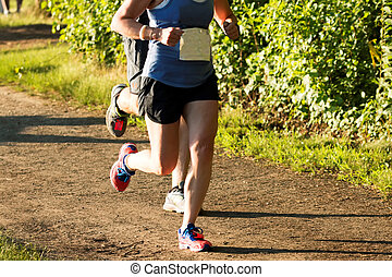 Runners racing a 5K on a dirt path