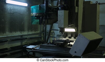 Running a milling machine with CNC and a flow of cutting...