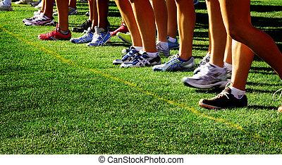 Running a Race - Runner running a cross country race on...