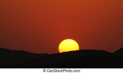 running along edge in sunset.mov