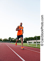 Running At the Track - African American man in his 30s...