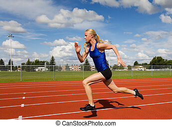 A female track star sprinting down the race track