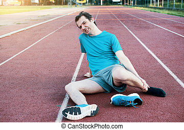 Running athlete feeling pain because of injured ankle