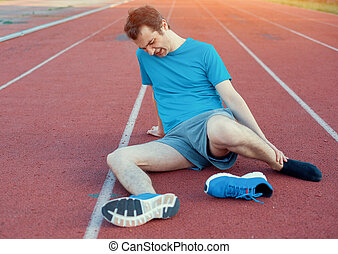 Running athlete feeling pain because of injured ankle -...