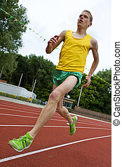 Running athlete in mid-air - Running athlete on a middle...