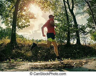 Running athlete man. Male runner sprinting during training