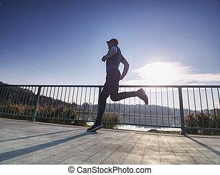 Running athlete man, side full body view. Male runner