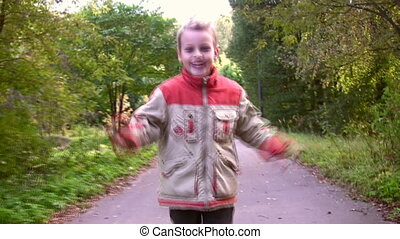 running child in autumnal park - Running child in autumnal...
