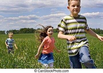 running children - children on a meadow
