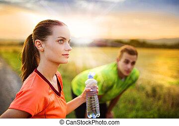 Running couple having break