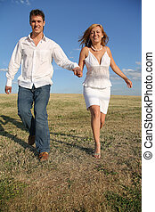 running couple on meadow