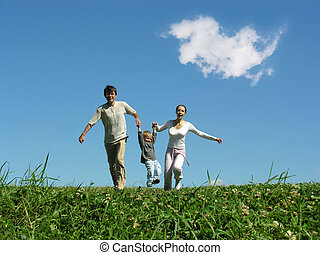 running family under blue sky