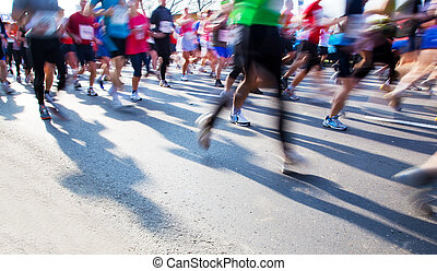 Running fast in marathon, legs close up. Sport, competition, energy.