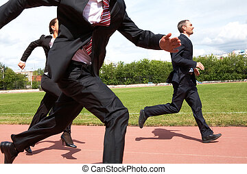 Running fast - Photo of energetic business people in suits ...