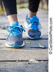 Running feet of young woman closeup on shoe