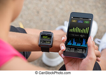 Running Female With Mobile Phone Connected To A Smart Watch...