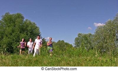 running friends on grass