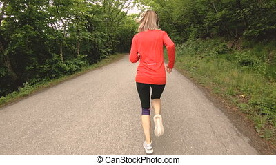 Running girl. Blonde girl doing outdoor sports in the summer...