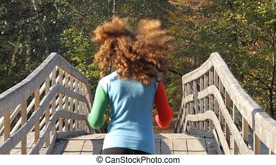 Running girl on a bridge