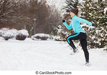 Running girl wearing sportswear, winter fitness