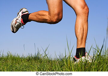 Iconic running image. Freeze action closeup of running shoes and legs in action.
