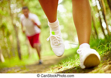 Running - Image of human feet in sportshoes running down...