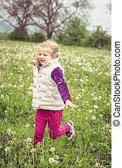 running in spring meadow