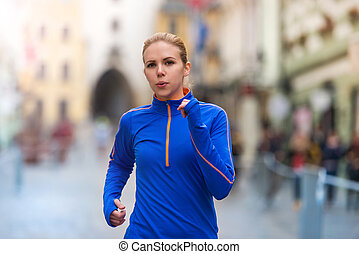 Running in the city - Beautiful young woman running in the ...
