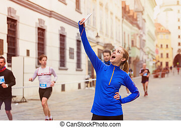 Running in the city - Beautiful young woman running in the...