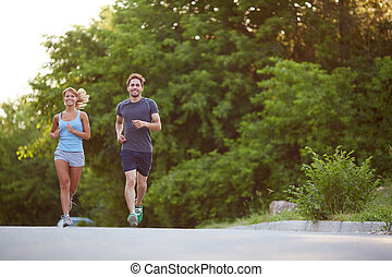 Running in the morning - Photo of happy couple running...