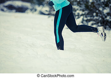 Running lady legs, sporty clothes, winter fitness