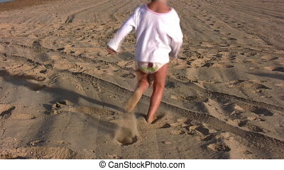 running little girl on sand alone
