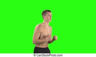 Running man athletic. Green screen. Slow motion