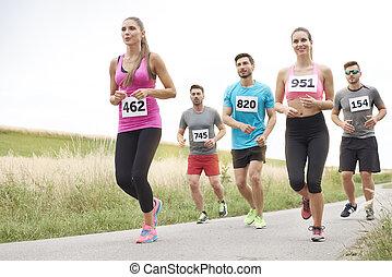 Running marathon in the non urban scenery