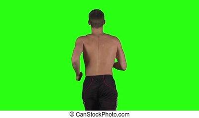Running muscular man. Green screen. Slow motion